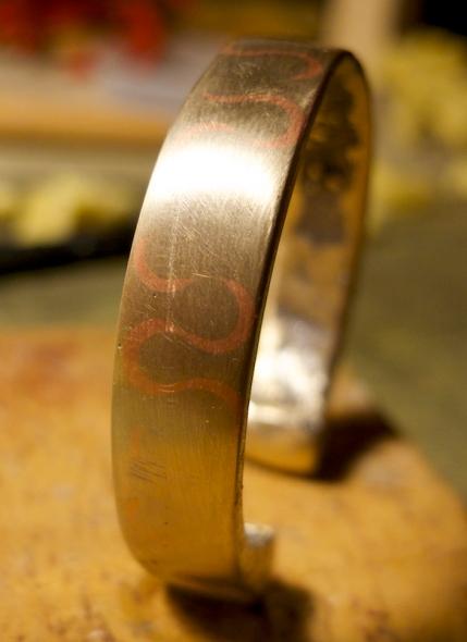 Bronze bracelet with copper inlay